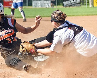 Ashley Davis (32) of Springfi eld and Mahoning County slides home safely as Melissa Weitzman, right, of Girard and Trumbull County applies the tag during Wednesday's high school softball all-star game at Mauthe Park in Struthers.