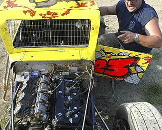 ROBERT K. YOSAY | THE VINDICATOR..Tod Rhodes of Leetonia - last years champion checks over his car  - the car sports a rebuilt Kawasaki engine -30-