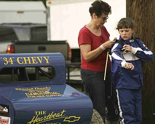 ROBERT K. YOSAY | THE VINDICATOR..Not just a guys  raceing as Carolyn Bays adjusts the seat belt harness of Maranda Myers before the race  . both are from Minerva .-30-