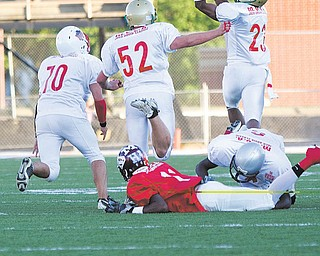 East's Martez Penn (6), playing for Mahoning County, brings down Trumbull's Deandre Abron of Liberty, allowing Mahoning's Aaron Edwards (23) of Ursuline to intercept a pass meant for Abron during the 26th Annual Jack Arvin Football Classic on Thursday at Mollenkopf Stadium in Warren. Ursuline's David Rossi (52) and Louie Alexander of Western Reserve were in on the play, which put Mahoning in position to score on the next play.  Mahoning won 34-26.