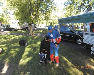 Erik Cromer of Austintown, as Captain America, poses with his son, Blake Cromer, dressed as Batman.