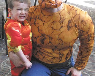 "Jason Markey of Poland is pictured here with his son, Aidan, who wanted a ""Fantastic Four"" theme for his 4th birthday party. Aidan dressed up as ""The Human Torch,"" and Jason joined in the celebration by dressing up as the ""The Thing."""