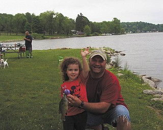 David LaRosa of Boardman took his daughter, Zoe, on her first fishing trip at Guilford Lake.