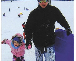 "Brian Richard of Boardman and his 3-year-old daughter, Celesta, are pictured sled riding at Rocky Ridge. It was Celesta's first time sledding on a ""real hill."""