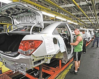 In this photo made June 15, 2010, Matthew Mines assembles a test model of the new Chevrolet Cruze at General Motors' Lordstown Assembly Plant in Lordstown, Ohio. (AP Photo/Mark Duncan)