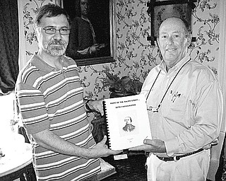 "David Shivers, president of the Salem Historical Society, left, presents David Hazen, a new member of the society, a copy of Dale Shaffer's book, ""More of the Salem Story With Photographs."" The historical society is offering a copy of the book, an $18 value, with all new memberships until Jan 1, 2011. The book, written in 1992, features more than 88 articles covering a wide range of subjects. Those who are interested can contact the society at 208 S. Broadway in Salem by mail or visit Monday and Wednesday mornings. Call 330-337-8514."
