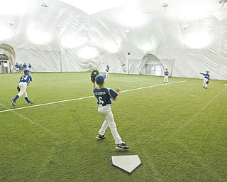 Youth baseball players practice at the Glacier Baseball Facility in Struthers inside the dome.