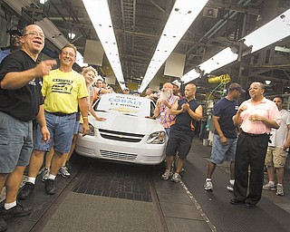 Lordstown GM employees walk the last Cobalt down the conveyor belt on, Wednesday, June 23, 2010.