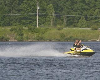 ROBERT K. YOSAY | THE VINDICATOR..IN FOCUS .Hot times as a Jet ski skims  across Lake Milton ..-30--