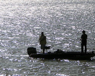 ROBERT K. YOSAY | THE VINDICATOR..IN FOCUS .Two anglers ply their luck on Berlin Lake in Berlin Township Berlin Lake is renowned for its excellent walleye fishing and is one of the very few lakes in the area in which natural reproduction of the walleye population occurs. Anglers will also enjoy fishing for the largemouth and smallmouth bass, muskie, crappie and bluegill which abound in the lake. ..-30--