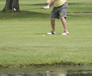ROBERT K. YOSAY | THE VINDICATOR...Salem Hills GC-  Hole #4  Light green Shirt is Ben Broderick- Yellow Shirt Tan shorts Chad Hanysh and Yellow Shirt and Dark  Shors is John Clacko  -30--