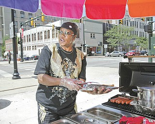Blanche Silva, who runs a hot-dog stand in downtown Youngstown, would be prohibited from operating the business when a new law goes into effect Sept. 13. Here she operates at West Federal and North Phelps streets.