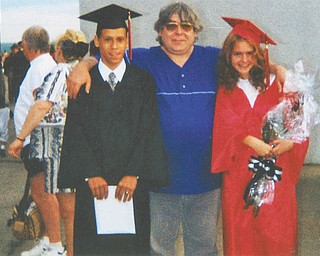 Joseph Scullen, center, is flanked by Rafael Ferrer Jr. and Christina Scullen, both 1997 graduates of Campbell Memorial High School.