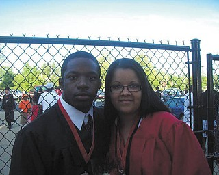 Reggie Ware and Rayana Rivera are shown on graduation day from Campbell Memorial High School.