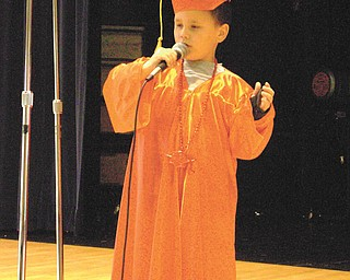 Nicholas McGoogan serenades his family and friends with a song at Campbell Elementary School Preschool.
