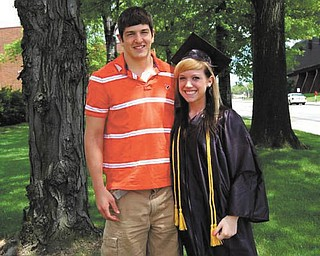 Derek Gustovich of Mineral Ridge share the moment with graduate Kara Cetar of Niles..