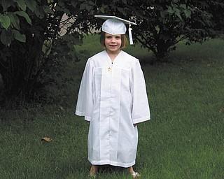 Olivia Rossi of Austintown is shown at kindergarten graduation from Ursuline Preschool and Kindergarten.