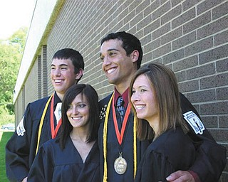 These four Mineral Ridge grads who live in the same neighborhood pose together on graduation day: Kyle Borton, Kristen Basista, Anthony Pannunzio and Tanya Evans.