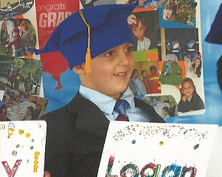 Logan Green from Boardman graduated from preschool at Discover My World.