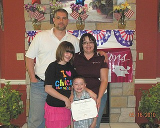 Julie Blakeman of Boardman received her masterÕs in business administration from the University of Phoenix. With her are her husband, Dan, and her children, Rio Blakeman and Brittany Morris.