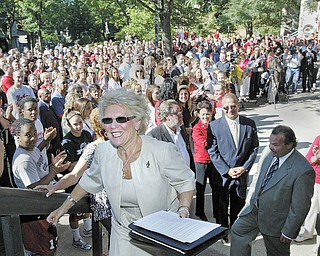 Cynthia E. Anderson, Youngstown State University's new president, leads the way up the steps of Tod Hall after inviting about 500 well-wishers inside for refreshments as she began her first day on the job Thursday. The crowd gathered in front of Tod Hall at 9 a.m. to greet her.