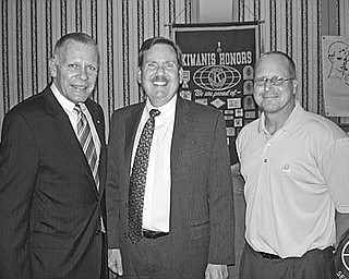 """Laying down the law: """"Essential Estate Planning Documents"""" was the theme of Jeffrey D. Heintz, center, an estate planning and probate law attorney with Manchester, Bennett, Powers & Ullman, when he spoke at the June 18 meeting of the Kiwanis Club of Youngstown at the YMCA. His talk covered durable powers of attorney, wills and trusts and how these legal documents play an important role in two phases of life, disability and death. Joining Heintz after his presentation were, from left, Chris McCarty, Kiwanis Club president, and Robert Gardner, CPA and financial adviser with the Bennett/Gardner Group, Butler Wick Division of Stifel Nicolaus & Co., program sponsor."""