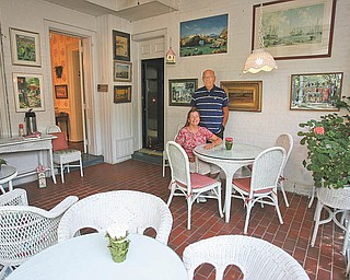 Flo Rance and her husband, Michael, take a break in the inn's dining area. Michael Freeman, a professor at Harvard University's medical school, bought the inn, and Mrs. Rance, Freeman's aunt, and his cousin, Chris McQuown, are overseeing the daily operations.
