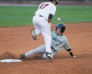 Geoffrey Hauschild|The Vindicator  .Vermont Lake Monster, Blake Kelso, arrives safely at second base after Mahoning Valley Scrapper, Kevin Fontanez, tries to gain control of a ball thrown his way during the fifth inning at Eastwood Field on Thursday evening.