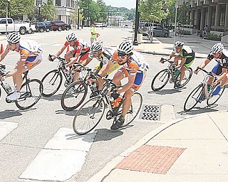 BIKE RACE - Racers taking a turn at 30 mph downtown Youngstown Sunday afternoon. - Special to The Vindicator/Nick Mays
