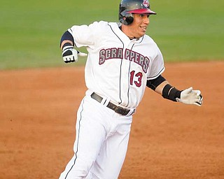 Mahoning Valley Scrapper, Asdrubal Cabrera, a player with the Cleveland Indians recovering from an injury, reaches second base after hitting a double during the fifth inning of a game at Eastwood Field in Niles on Monday evening.