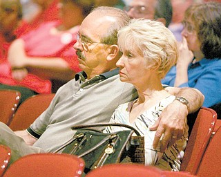 Stephen and Dianna Ferro of Warren listen to testimony given Tuesday at a field hearing at Canfield High School about cuts made to Delphi salaried retireesÕ pension benefits..
