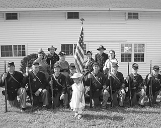 Historical times recreated: The 105th Ohio Volunteer Infantry and Argus Lodge will host the sixth biannual Civil War Reenactment July 24 and 25 at Argus Park, 5050 Shields Road, Canfield. Gates will be open from 10 a.m. to 4:30 p.m. each day, and visitors will have an opportunity to visit camps and talk with the soldiers. Battles are scheduled for 2 p.m. both days. Speakers will portray Gen. Robert E. Lee, Gen. Ulysses S. Grant and President Abraham Lincoln. There will be historical presentations, dress parades, and Gatling gun and live mortar fire demonstrations. Admission is $5 for adults. Children 10 and under are admitted free. Shown wearing authentic Civil War-era clothing are a few of those who will participate in the reenactment.