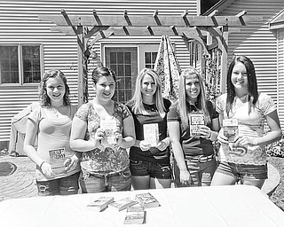 Book smart: Boardman-Poland Juniorettes members are having their third annual used book sale today from 9 a.m. to noon in the pavilion at Prince of Peace Evangelical Lutheran Church, 2985 Center Road, Poland. The group, which consists of girls ages 12-18 who are interested in volunteering in their communities, is sponsored by Boardman-Poland Junior Women. Among the members involved with today's sale are, from left, Bianca Klase, Maddie Crish, Christina Ford, Kirstin Weaver and Johanna Dunkel.