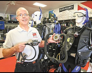 ROBERT K. YOSAY | THE VINDICATOR..Showing two types of breathing apparatus one from 50 years ago...Bob  Tyger --B & B Diving Specialties, a skin diving and scuba shop, is celebrating its 50th anniversary. The store used to be based in Youngstown. .-30