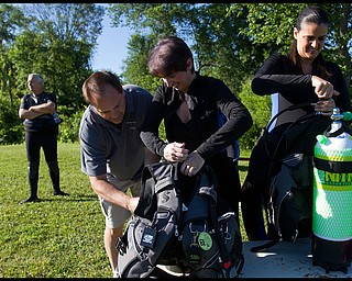 Geoffrey Hauschild.Director of Training, Shawn Campbell, helps Dr. Candice Macri, of New Castle, assemble her diving equipment alongside Judge Jennifer Nicholson, Lawerence County Magistrial District Judge, at B&B Diving in Hillsville PA.