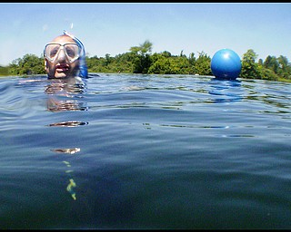 Geoffrey Hauschild|The VIndicator.Director of Training, Shawn Campbell, in Fox Quarry a lake created from an old limestone quarry B&B Diving in Hillsville PA.