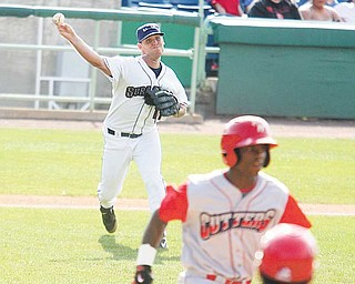 Scrappers pitcher Jordan Cooper fires to first base after fielding a bunt during Sunday's game at Eastwood Field.
