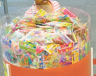 The rubber bands return to their original shape when you take them off. Alyssa Caney, 4, of Youngstown, peruses the selection bin at the store.
