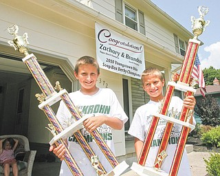 Zach Krohn, 12, left, and Brandon Krohn, 10, both of Austintown, the first brothers to win the Greater Youngstown Area Soap Box Derby, will travel to Akron for the All-American Soap Box Derby on Saturday.Zach and Brandon will compete in the in the super stock and stock divisions, respectively.