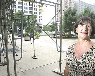 A downtown Youngstown building still has scaffolding around it two years after it was erected. Sharon Letson, executive director of Youngstown CityScape, says the scaffolding adversely impacts the look of downtown..