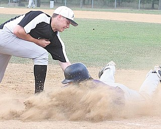 Tyler Bowditch, left, an infielder for J&A baseball of Lakewood, puts the tag on a Dave Sugar excavating baserunner during a game Tuesday in the second round ofthe Connie Mack Class B Baseball Tournament at Cene Park in Struthers. Up 3-0 early in the game, things turned sour for Dave Sugar when in the bottom of the sixth inning two fielding errors led to three runs for J&A. The final score: J&A 6, Dave Sugar 3.