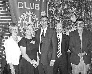 Youngstown Rotary Club met July 10 for a formal dinner and an installation ceremony at Youngstown Country Club. During the event the board of directors presented gifts of appreciation to Mary Womble, second from left, in recognition of her year of service as president and the many projects completed during the 2009-2010 term. Shown with the honoree are the newly inducted officers, from left, Carol Chamberlin, treasurer; Steve Kristen, president; Marc Mazzella, vice president; and Ron Farino, secretary. Not present was Suzanne Fleming, president-elect.
