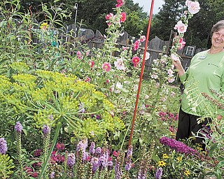 Horticulture Educator Anita Wesler among the many flowers on display at Fellows Riverside Garden.