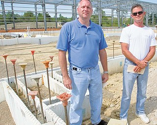 Mark Marvin, left, the owner of Reinforcement Systems, and Mark Shoaf, project manager for the 98,000-square-foot factory are seen here. The plant, which will employ up to 65 people, will produce welded reinforcements for concrete construction.    .