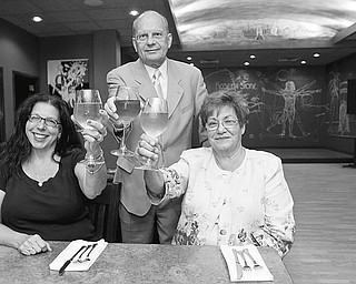 "Co-Chair of Fundraising, Charlotte Diss, and Co-Chairs of the Centennial Committe, David Ivko (back) and Mary Ann Garasic, raise their glasses at Rosetta Stone Café in anticipation of the upcoming ""Wine Taste Extravagana"" to be held at the restaurant on August 1, 2010 to benefit the 100th Anniversary of Sts. Peter and Paul Croation Roman Catholic Church."