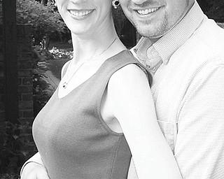 Marissa L. Mikolich and Andrew W. Mickley