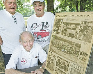 """The club had dubbed its Sunday event """"Cars in the Park,"""" and this is the 32nd year it has sponsored the showing of antique vehicles. Posing with a 1979 Vindicator story about the club are, in front, Pete Draia of Youngstown, and in back, Joe Phillips of Boardman, left, and Dave Bayowski of Mineral Ridge."""