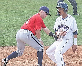 Scrappers baserunner Kevin Fontanez beats the tag of Spikes infielder Matt Curry during Sunday's game in Niles.