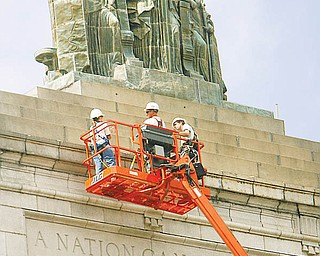 Mahoning County commissioners are expected to reallocate $177,000 Wednesday to remove and store this statue from the top of the county courthouse on Market Street..