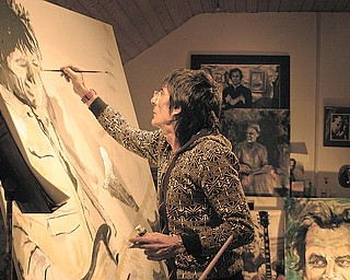 Ronnie Wood, guitarist with the legendary rock group The Rolling Stones, paints a self-portrait. An exhibition of his artwork opens Sept. 21 at the Butler Institute of American Art, Wick Avenue, Youngstown.